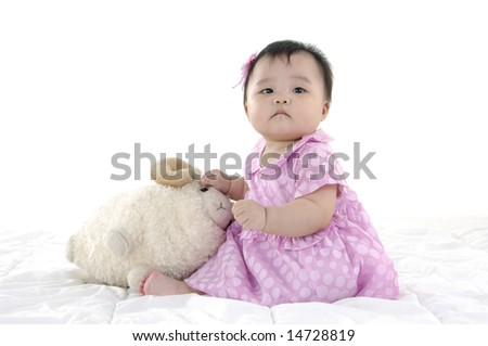 Small baby with laptop isolated