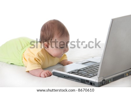 Small baby with laptop over white