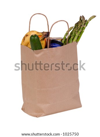 Small bag of groceries isolated on white with clipping path outline. - stock photo
