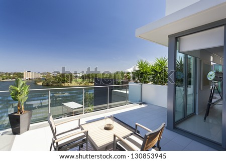 Small balcony overlooking the suburbs - stock photo