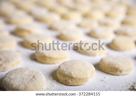 Small balls of fresh homemade dough for donuts  - stock photo