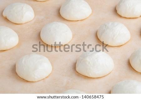 Small balls of fresh homemade pizza dough - stock photo