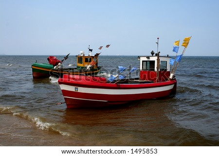 Small Baltic fishing boats on the Sopot beach in Poland - stock photo