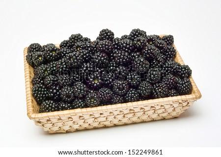 small basket full of blackberries - stock photo