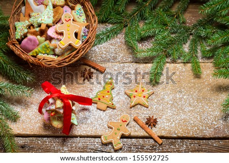 Small basket full of gingerbread cookies for Christmas - stock photo