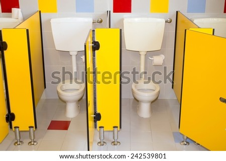 small bathroom of a preschool for children with water closet