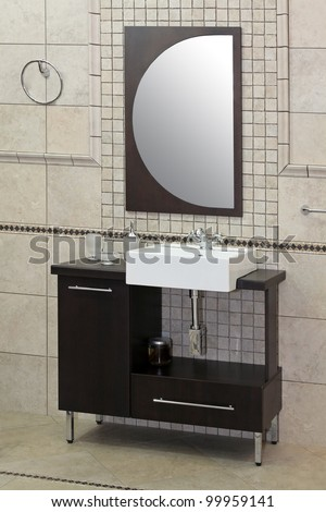 Small bathroom sink in modern interior with large mirror - stock photo