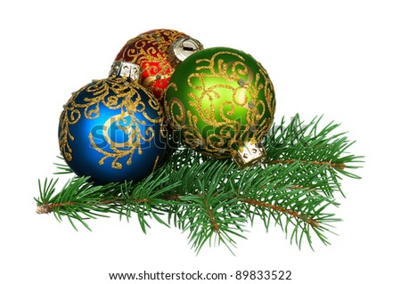 Small baubles on green christmas firtree on white background