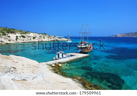 Small bay with beach and boats on Plati island (near Kos island, Greece) - stock photo
