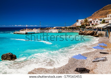 small beach in front of the bay in the centre of Chora Sfakion, Crete, Greece - stock photo