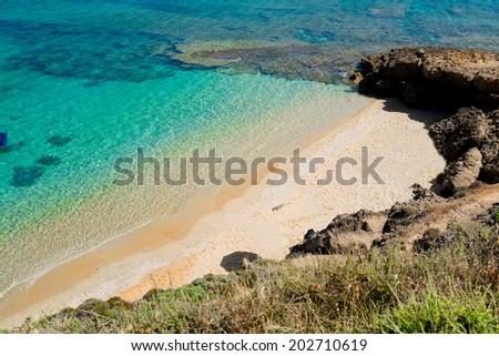 Small beach in Torre dei Corsari Along Green coast, West Sardinia, Italy - stock photo