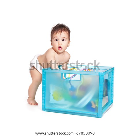 small beautiful baby boy with a blue box - stock photo