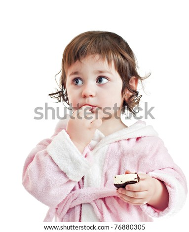 small beautiful baby girl with candy isolated on white - stock photo