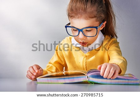 small beautiful child reading a book - stock photo