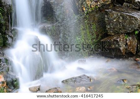small beautiful fresh water mountain creek waterfall in summer - stock photo