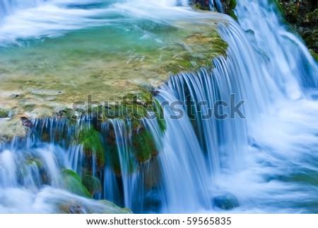 small beautiful waterfall on a mountain river - stock photo