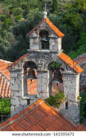 Small bell tower of the Orthodox Church. The monastery Gradiste, Montenegro - stock photo