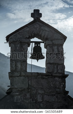 Small bell tower of the Serbian Orthodox Church. The monastery Gradiste, Montenegro - stock photo
