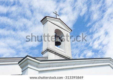 Small bell tower with a bell of a country church i - stock photo
