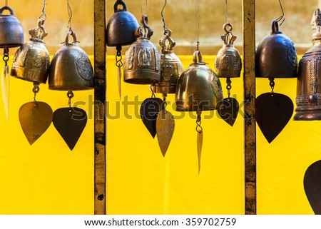 Small bells in Buddhist temple - stock photo