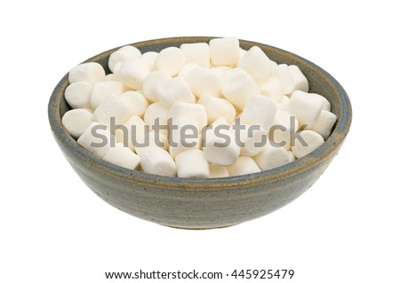 Small bite size marshmallows filling an old stoneware bowl.