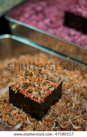 Small bits of fish and spices at a market in Japan. - stock photo