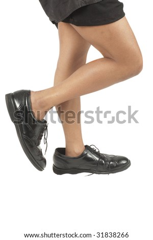 small Black woman walking in large mans shoes