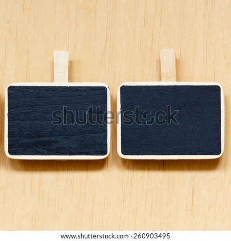 small blackboards slate chalk boards with space for text menu on wooden surface, empty blank sign - stock photo