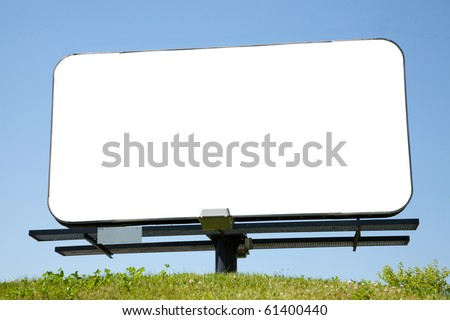 Small blank billboard on green grass against blue sky for your advertisement - stock photo