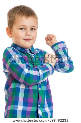 small blond boy in a plaid shirt demonstrates his biceps ,boy plays sports in kindergarten , close-up-Isolated on white background - stock photo