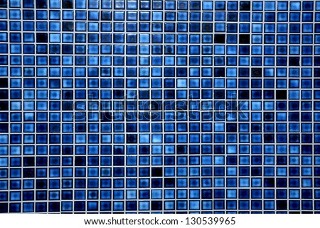 Small blue modern mosaic tile in a bathroom. - stock photo