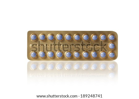 small blue pills in a blister - stock photo