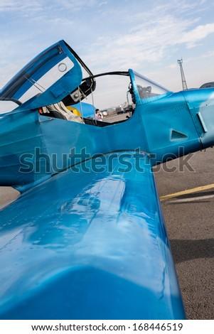 Small blue plane - stock photo