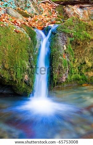 small blue waterfall - stock photo