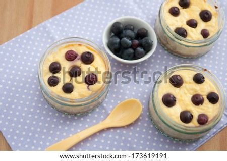 Small Blueberry Cheesecake in a jar - stock photo