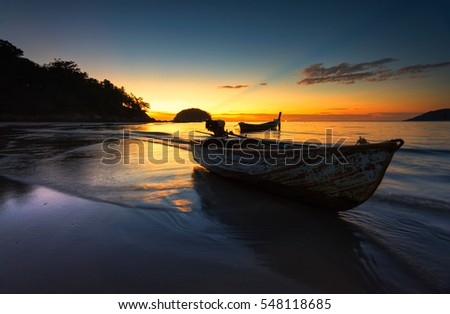 Small boat at the Andaman Sea  at sunset