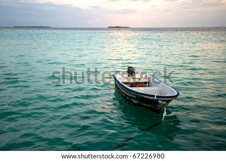 small boat in the ocean - stock photo