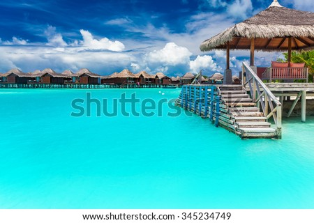 Small boat jetty on a tropical island of Maldives with vibrant blue lagoon - stock photo