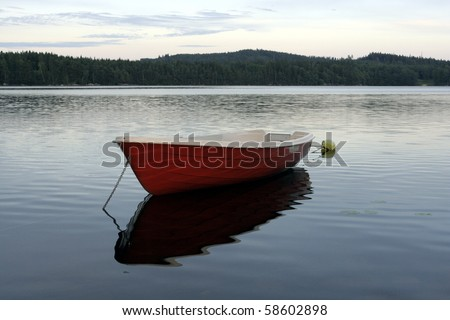 Small boat on a lake in Sweden - stock photo