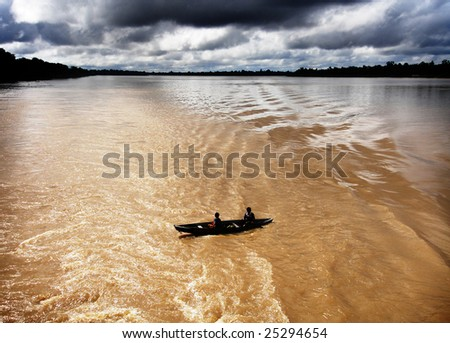 Small boat on the Amazon River - stock photo