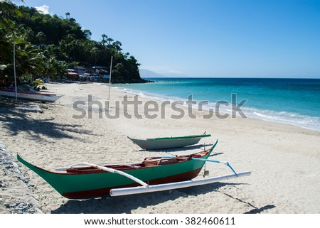 Small boat on white beach on the island - stock photo