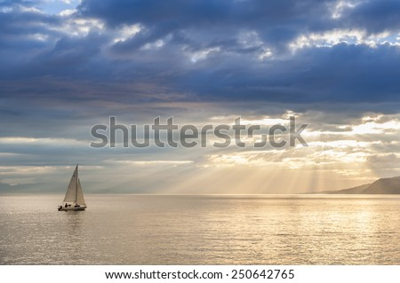 Small boat sailing on Leman lake, Switzerland. - stock photo