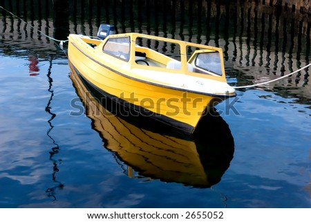 Small boat tied up to a wharf