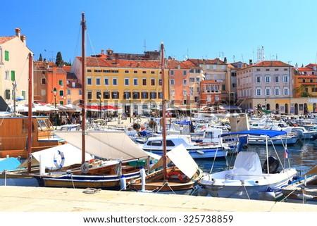 Small boats anchored inside the harbor of Rovinj, Croatia - stock photo