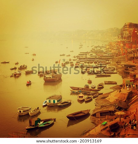 Small boats at Ganga river - instagram effect. Sunrise photo with retro filter. - stock photo