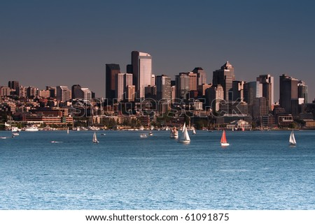 small boats in lake union in front of seattle skyline - stock photo