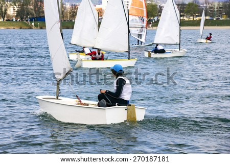 Small boats sailing on the lake on a beautiful sunny day - stock photo
