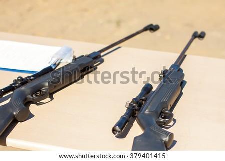 Small-bore pneumatic weapon. The small-bore pneumatic weapon on a table.Small-bore air rifle. - stock photo