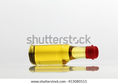 small bottle of cooking oil on the white background