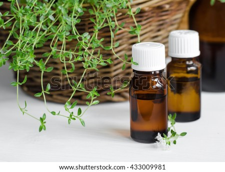 Small bottle of essential thyme oil